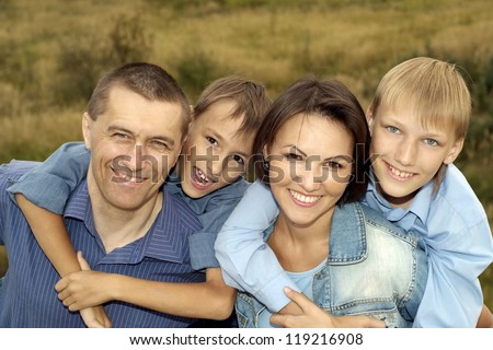 big cute family posing outdoors in summer - stock photo