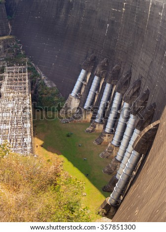 Big dam. Dam in the Mountains, Water barrier dam, Hydro Power Electric Dam. - stock photo
