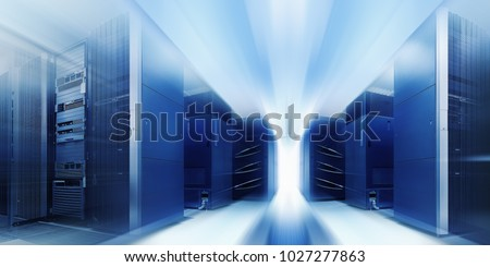 Big data and information technology concept. Communication equipment room with lighting in data center with blur and motion.