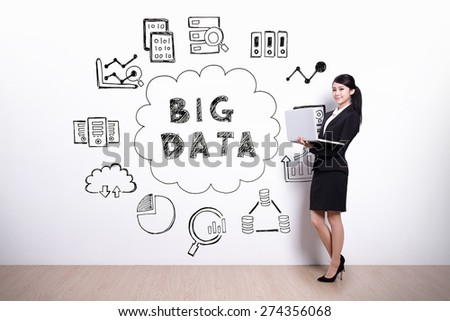Big Data concept - business woman using laptop computer with hand drawing Big Data concept background - stock photo