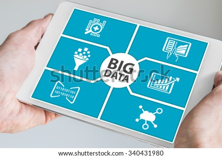 Big data concept. Hand holding tablet. - stock photo