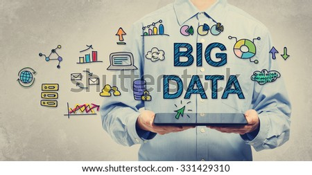 Big Data concept with young man holding a tablet computer  - stock photo