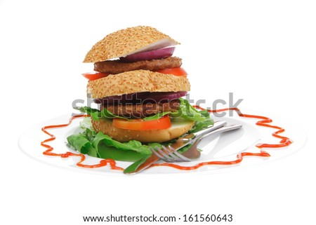 big double grilled hamburger on ceramic plate isolated  over white background