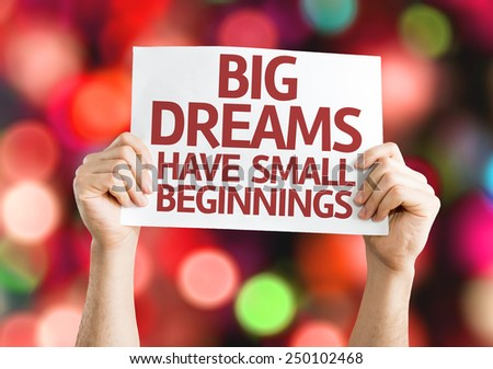 Big Dreams Have Small Beginnings card with colorful background with defocused lights - stock photo