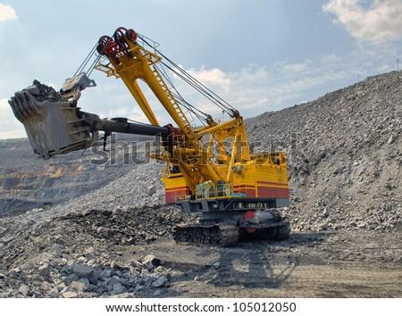 big dredge digs a iron ore - stock photo