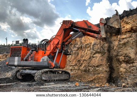 big dredge digs the earth - stock photo