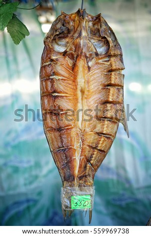 Big dried fish on a string