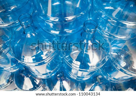 big empty water bottles at warehouse - stock photo