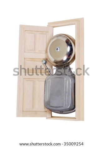 Big entrance shown by an oversize antique doorbell in the doorway - path included - stock photo