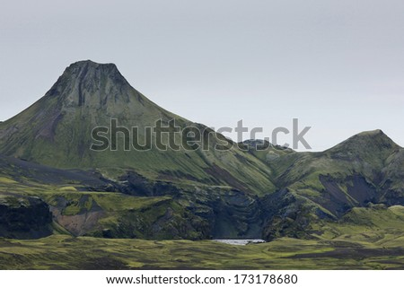 Big eruption crater covered with moss on a cloudy day at Lakagigar, Iceland - stock photo