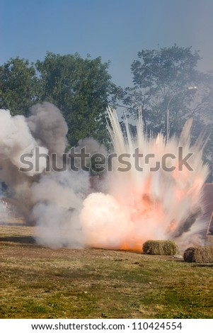 Big Explosion on the field with hay - stock photo