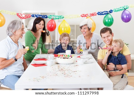 Big family celebrating birthday together at home - stock photo