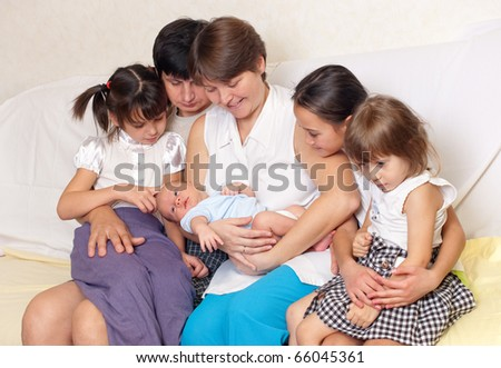 Big family home on the couch - stock photo