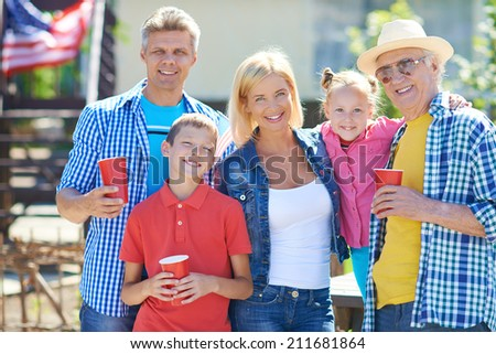 Big family of five spending tome outdoors - stock photo