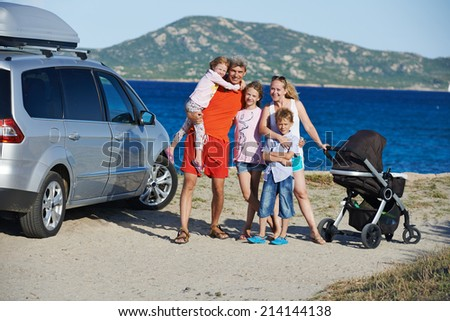 Big Family. Parents with four children on sea, lake or ocean shore at vacation - stock photo