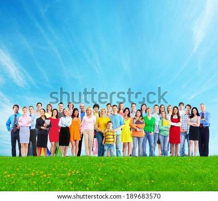 Big family people group over blue sky background. - stock photo