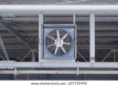 Big fan for sucking air inside to outside of factory. - stock photo