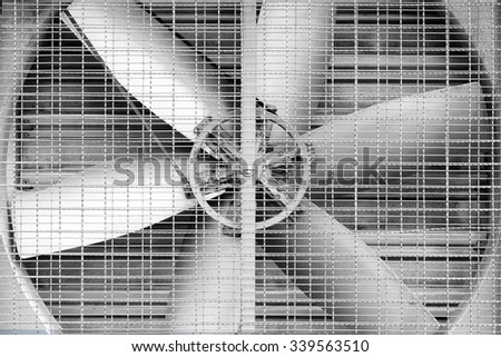 Big fan in the factory background - stock photo