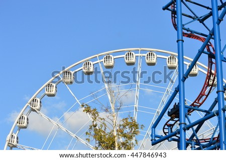 big Ferris wheel at an amusement park in the blue  sky, Russia