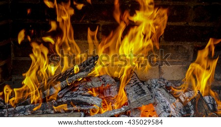 Big fire from wood burning in an oven - stock photo