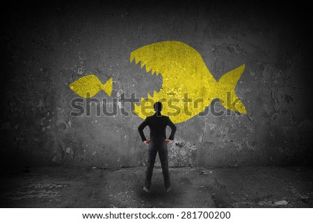 big fish eating little fish - stock photo