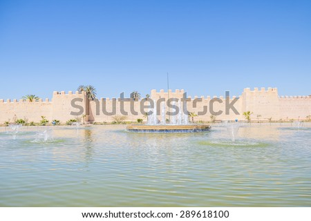 Big fountain in front of historic ramparts in Taroudant, Morocco - stock photo