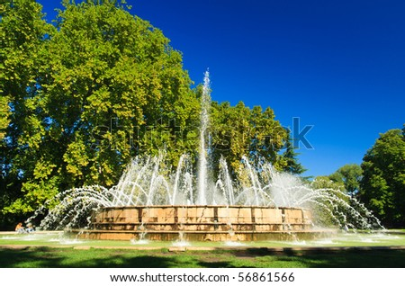 big fountain in the green park - stock photo