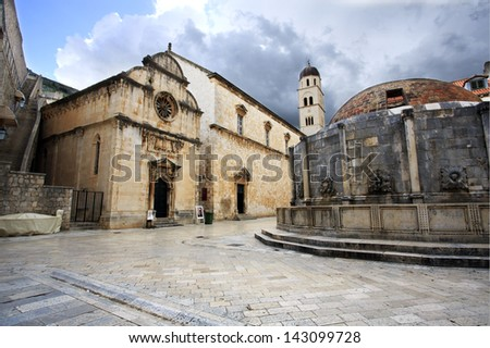 Big fountain of Onofrio and Franciscan monastery  at dawn in Dubrovnik, Croatia - stock photo