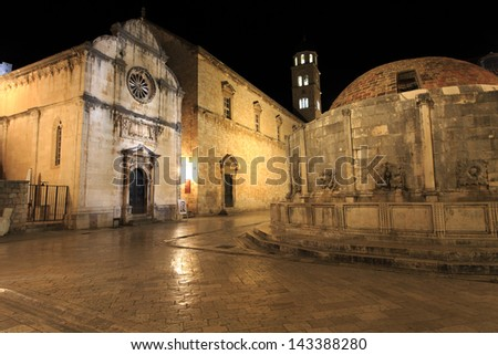 Big fountain of Onofrio and Franciscan monastery at night in Dubrovnik, Croatia - stock photo