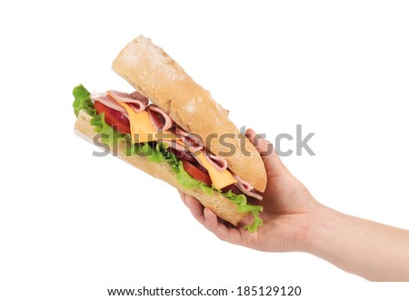 Big fresh sandwich in hands. Isolated on a white background. - stock photo