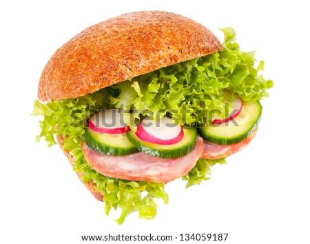 Big fresh sandwich of graham roll with vegetables mix and sausage, healthy food of lettuce, cucumber and radish isolated on white background, object in horizontal orientation, nobody.