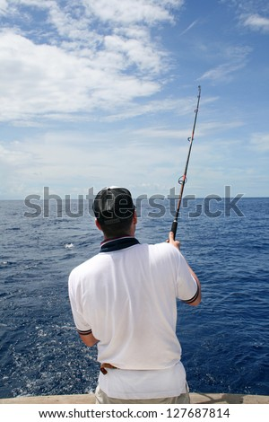 Big game fishing. A fisherman in a boat fight against a fish. Madagascar - stock photo