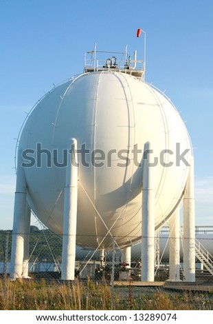 Big gas container against the blue sky