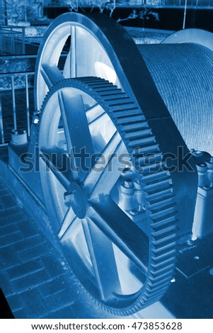 Big gear in an industrial park, closeup of photo