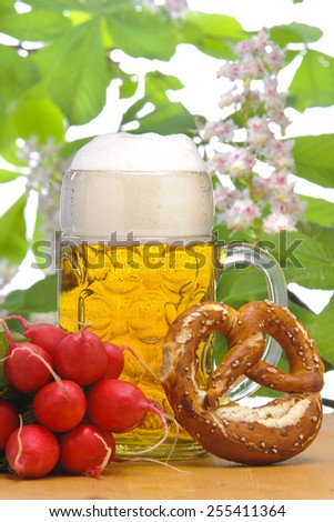big glass of bavarian lager beer while Oktoberfest in Munich - stock photo