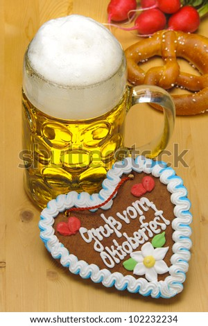big glass of german bavarian beer at world famous beer festival Oktoberfest  in Munich - stock photo