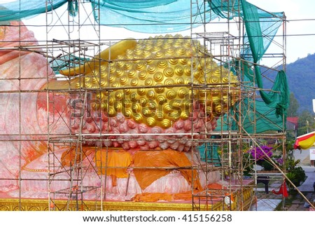 Big Golden Buddha statue Repair in Thai temple at Songkhla Southern Thailand :Select focus with shallow depth of field.