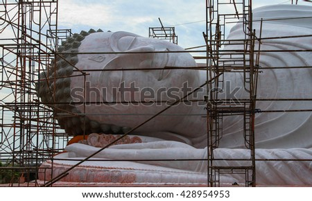 Big Golden Buddha statue Repair:Select focus with shallow depth of field.