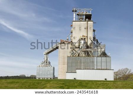 Big Grain Elevator In Field - stock photo