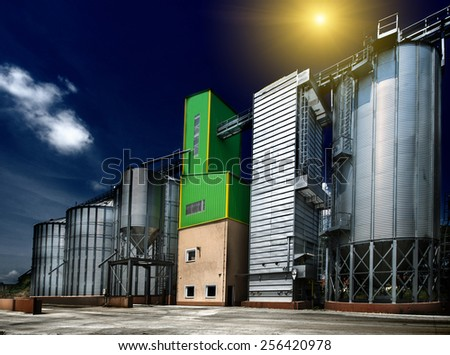 Big grain silos exterior on sunny day - stock photo
