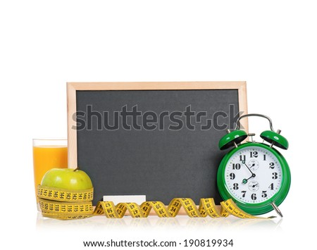 Big green alarm clock with breakfast and blackboard, isolated on white background  - stock photo