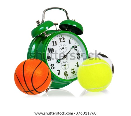 Big green alarm clock with small balls, isolated on white background - stock photo