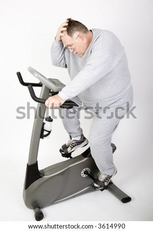 Big Guy Working off the fat on the exercise bike