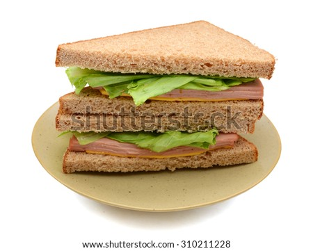 big ham sandwich on plate isolated on white  - stock photo