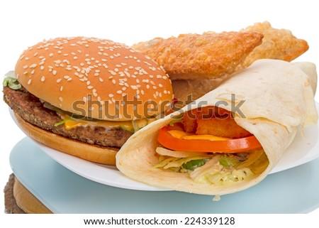 Big hamburger.  Fish Roll and Pie on white plate - stock photo