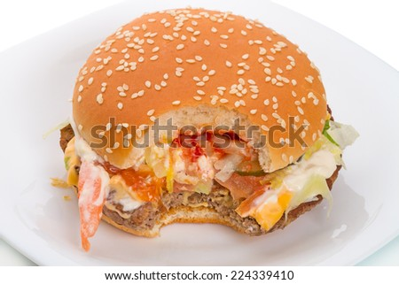 "Big hamburger from a natural whole beef with a slice of cheese ""cheddar"" on caramelized bun, seasoned with mustard, ketchup, onions, two slices of pickles, fresh lettuce, a slice of fresh tomato"