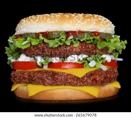 Big hamburger isolated on black background - stock photo