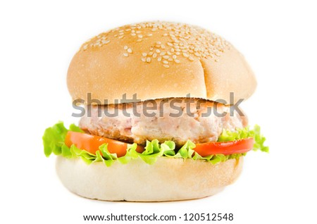 big hamburger with tomato , lettuce and fried pork