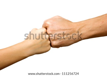 big hand and little hand as fists together isolated on white background