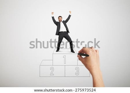 big hand drawing winners podium. happy laughing businessman in formal wear standing on sport winners podium and raising his hands up over light grey background - stock photo